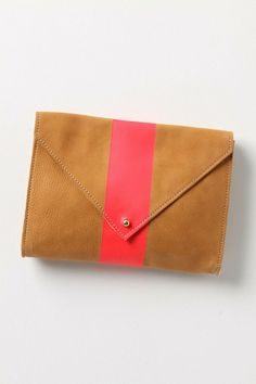 Ditch the heavy handbag and use a compact clutch. Just bring the essentials: phone, keys, cards