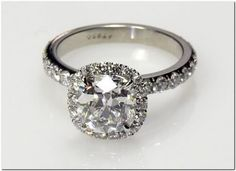 "Tacori - a ""cushion"" shaped halo surrounding a round solitaire with no gaps in-between."