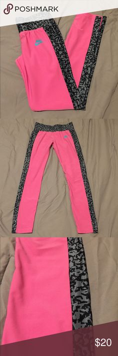 NWOT Nike pants NWOT, ripped tags off thinking I was going to wear them, never end up wearing. pink/grey pattern down outside of legs. Full length. Elastic waistband. Girls XL equivalent to women's XS/small. I am typically a small in Nike bottoms, or a 2/4 in pants and these fit me- but they are form fitting, like leggings are. Nike Pants