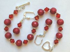 This bracelet and earring set is made with 8mm wine red textured glass stardust beads. I have accented them with 2.5mm fluted silver beads and 6mm Indian