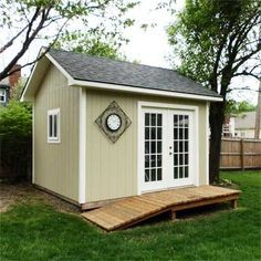 French doors add a touch of glamor to this hardworking backyard tool shed. | thisoldhouse.com