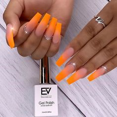 Love the neon orange ombre? This mani features nude coffin shaped nails with a neon orange ombre design. Acrylic Nails Coffin Ombre, Orange Acrylic Nails, Bright Summer Acrylic Nails, Simple Acrylic Nails, Fall Acrylic Nails, Fall Nails, Easy Nail Art, Orange Ombre Nails, Yellow Nails