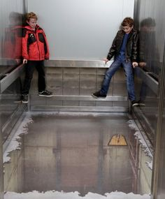 Optical illusion of collapsed floor of the lift, London, UK.