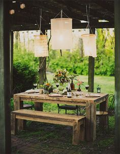 hanging lamps above a tablescape rustic wedding ideas