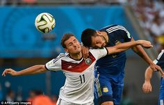Target man: Miroslav Klose (left) goes up for a header with Argentina defender Ezequiel Ga. Jamie Redknapp, World Cup Final, World Cup 2014, Lionel Messi, Master Class, Header, Finals, Target, Argentina