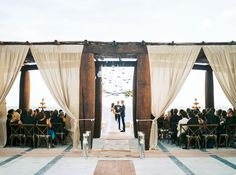 Mexico.. Photography : Ashley Bosnick Photography | Ceremony Venue : The Resort At Pedregal | Wedding Dress : Vera Wang | Grooms Attire : Bespoke | Reception Venue : Villa Turquesa | Wedding Planning + Design : Elena Damy Floral Design Read More on SMP: http://www.stylemepretty.com/2016/04/04/see-how-modern-chic-a-cabo-san-lucas-wedding-can-be/