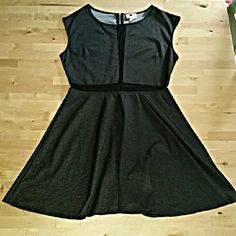 Little Black Dress Black with tiny white polka-dots. Sheer mid section and small part down the middle of the chest. Has a back zipper. Juniors large one clothing Dresses Mini