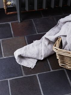 """Reclaimed Welsh Quarry Tiles—""""originally made for schools, hospitals, and factories""""—line the floor of the utility room and WC."""