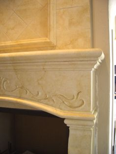 """The """"Artimino""""  close up view of the hand sculpted scrolling and the coloration on the mantel."""