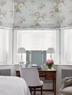 Ideas for blinds. Blinds are a cost-effective option for bay windows, as they use less fabric than curtains. They also take up less space and look neater pulled down behind a desk or dressing table – as in this project by Jane Churchill. Here, the radiators would be covered by curtains, so blinds are a sensible choice.  #curtainmaker #baywindow #blinds #inspiration