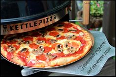 The KettlePizza: Woodfired #pizza in your own backyard! This is perfect #summer fun!