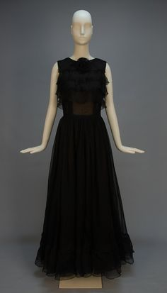 """BOHAN for DIOR COUTURE EVENING DRESS, SPRING-SUMMER 1963. Sleeveless black silk organza with four wide bodice ruffles and self flower at neck, full skirt of three layers, the outer with deep hem ruffle, the inner over ivory organza, ivory camisole and silk under skirt. Label """"Printemps-Ete 1963 Christian Dior Paris"""" stamped 120239"""