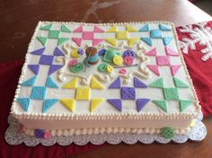 Quilt-themed cake for quilting guild Christmas Party.  Half-sheet, 2-layer with buttercream icing and fondant details.