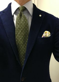 Navy jacket, light blue shirt, olive tie with white polka dots