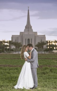 What a wonderful temple wedding . These two mormon lovebirds got married in the gilbert temple and we are loving the palm trees and the clouds on the wedding day. Modest wedding dress . Grey suit . Marriage . Love .