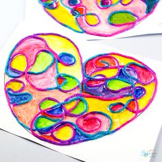 A fun and open-ended Yarn Squiggle Heart Art project for kids! The perfect craft for Valentine's Day or for anyone who loves hearts.