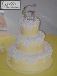 yellow frost with fondant punched flowers