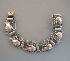 Norwegian sterling silver leaf bracelet with green cabochons.  Mid century modern .