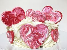 Valentine Hearts Cake Toppers using Wilton's Candy Melts and Cookie Cutters.