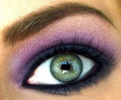 green eye with purple eyeshadow and navy liner