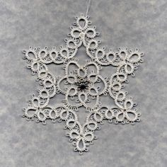 Star Snowflake. Book: Tatting by Myra Piper, out of print now. Pattern: Five Point Exquisite Star. Thread: HH hite 601 size 20. Medallion: http://www.firemountaingems.com