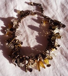 Bracelet, with glass beams on chain.