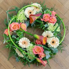A beautiful floral wreath that could be used to encircle an urn on display.