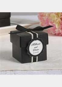 """Polishing the look of your wedding favors has never been easier. Simply choose the box style and label design that coordinates best with your wedding theme. Personalize favor tags with two lines of text First names, up to 28 characters including spaces and event date, up to 18 characters including spaces. Kit Includes: 2"""" x 2"""" x 2"""" black box with lid, 18.25""""L x 0.25""""W grosgrain ribbon, 9""""L x 0.5""""W satin ribbon and personalized tag.Boxes come unassembled; instructions included Minimum order…"""