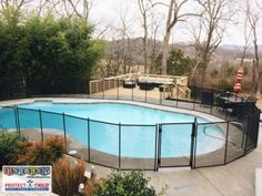 A beautiful removable mesh pool fence installed by Safe Baby Childproofing in Nashville, TN courtesy of Protect-a-Child Pool Fence. Simply the best fence on the market.