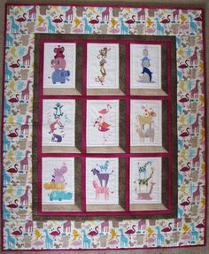 Baby quilt embroidered with animal stacks machine embroidery designs.  I loved how the machine embroidering and quilting was combined in this quilt.  Designs by emblibrary.com