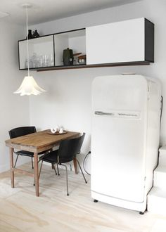Love the simplicity of this space. The plywood flooring, pendant light & old wood table.