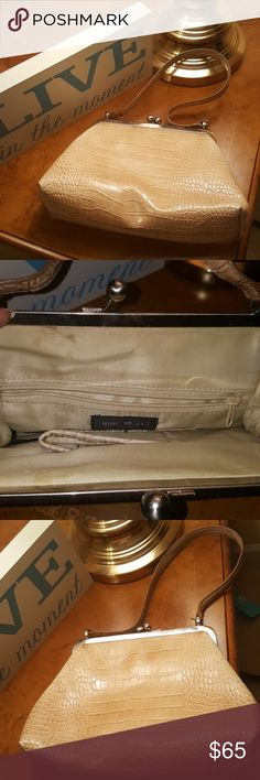 Vintage Nine West bag! Great condition! Vintage Nine West bag with vintage clasp and original strap no stains and leather in great condition! Nine West Bags Mini Bags