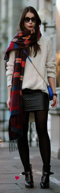 Plaid multicolored scarf mixed with a cable knit sweater and leather. This screams fall!
