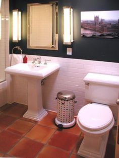 saltillo tile bathroom against white subway