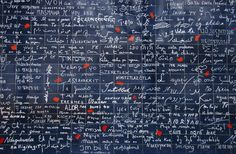"""""""I love you wall"""", Montmartre, Paris. Having collected the phrase «I love you» in over three hundred languages, the artist Frédéric Baron, wanted to display these messages of love on a wall. The """"I love you"""" wall stands at the centre of the Jehan Rictus garden, near to place des Abbesses at Montmartre, and covers a surface area of 40 m² with a total of 511 squares in enameled lava…"""