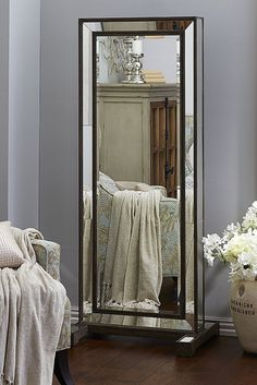 Pier 1's stunning Gabrielle Jewelry Armoire has all the traits of a neoclassically inspired beauty. Inside are ring holders, hooks for hanging necklaces and compartments for loose treasures. Beautifully hand-painted with a natural wood finish for contemporary flair and a French cleat for optional wall mounting.