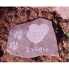 Neat idea for a memory walk out back...Uses for the dremel - rock carving