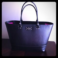 "Kate Spade Black Wellesley Medium Harmony Tote In like new condition. Clean inside and out. Pet free/smoke free home. Just little too big for me with my body frame, bought smaller replacement tote. Nice leather tote with zipper top. Can hold a lot. Check measurements above: base is 13"" and top is 18"" east/west type of bag. NO: trades, low balling, PP, or Mercari. Price is firm. Also listed on Tradesy, get it before it's gone! kate spade Bags Totes"
