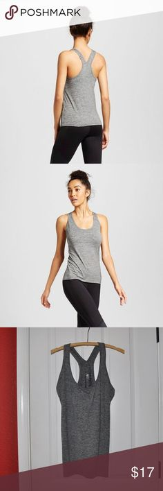 New CHAMPION Gray Performance Fitted Tank Top [C4] The Women's Performance Fitted Tank from C9 Champion is the perfect tank to throw on for a run or yoga. This versatile top helps keep you cool in any workout with wicking and breathable fabric.   size XL new without tags color: ebony heather (gray)  • Duo Dry+ technology wicks moisture and dries fast  • Stretch fabric that moves with you  • Breathable brushed fabric for soft hand  • Fitted  @cjrose25  More athletic clothes in my posh closet…