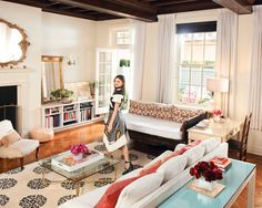 In the Upper East Side apartment of model Miranda Kerr, the otherwise traditional space is offset by the owner's bohemian approach to decorating—pairing a carved wooden daybed with an antique gilt mirror and glass coffee table.