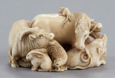 Lot: 68: An ivory netsuke of the junishi., Lot Number: 0068, Starting Bid: $1,000, Auctioneer: Quinn's Auction Galleries, Auction: The Mang Collection of Japanese Netsuke, Date: December 7th, 2012 CST