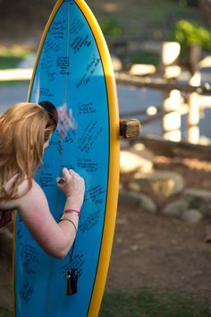 a surfboard used as a guestbook  Photography by http://bluephoto.biz, Wedding Coordination by rhoneweddings.blogspot.com