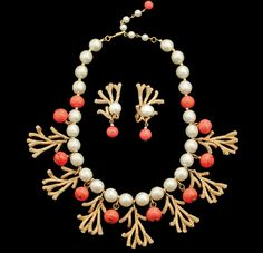 "A mid-1950s bib necklace, made of gold-plated brass, faux pearls, and glass beads, calls to mind the Great Coral Reef. (From ""The Napier Co."")"
