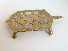 Brass turtle trivet (19.00 USD) by FromThenOn