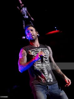 Singer Adam Levine of Maroon 5 performs on stage at the Barclays Center on June 15, 2015 in Madrid, Spain.