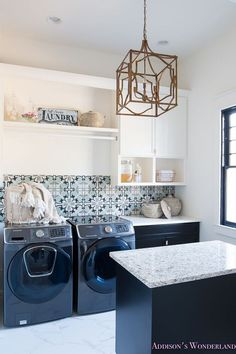 The laundry room is full of inspiring ideas, which includes the blue and grey cement tile backsplash. Love it! Flooring: Glacier Grey 12″ x 24″ Ceramic Tile