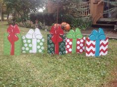 THIS LISTING IS FOR ONE PICKAGE OF YOUR CHOICE. Pick the one you want. Christmas Present for your garden or front yard. It is hand cut and and hand painted by ME. the tall presents measure 22 by 11 inches and the shorter ones are 20.75 by 17. When ordering please give me the color of the one(s) you want. If the color is not indicated then I will pick the most popular one(s). This present is made from exterior (outside) sign board that the manufacture says will last 20 years. It is also gl...