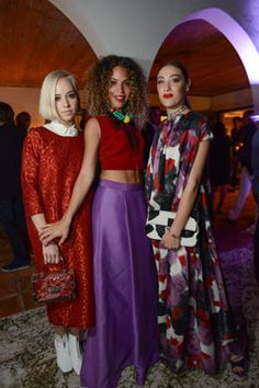 During Miami Art Basel, Margot, the stylist Cleo Wade and the D.J. Mia Moretti, played off each other's colors, textures and silhouettes, something the friends often do when approaching their holiday party outfits. (Photo: Casey Kelbaugh for The New York Times)