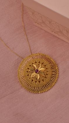Jewelry OFF! Fine granules of gold adorn the circular medallion with a floral centre. Gold Jewelry Simple, Gold Rings Jewelry, Jewelry Design Earrings, Gold Earrings Designs, Gold Jewellery Design, Necklace Designs, Gold Pendent, Gold Ring Designs, Centre