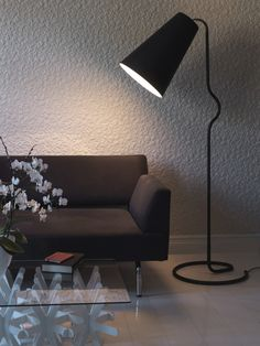 The Bender Floor lamp by Northern Lighting has been designed by Morten Kildahl . Bender is a large, floor-decor lamp that also works well as a reading lamp. The organic shape of the lamp starts at the floor with the textile wire running from the . Large Floor Lamp, Black Floor Lamp, Floor Lamps, Lighting Concepts, Lighting Design, Floor Standing Lamps, Luminaire Design, Lamp Design, Piece A Vivre